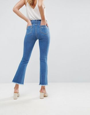 ASOS | ASOS Crop Flare Jeans in Mid Wash Blue with Raw Hem